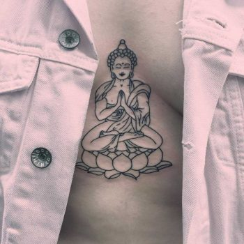 Buddha tattoo on the sternum