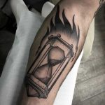 Burning hourglass tattoo