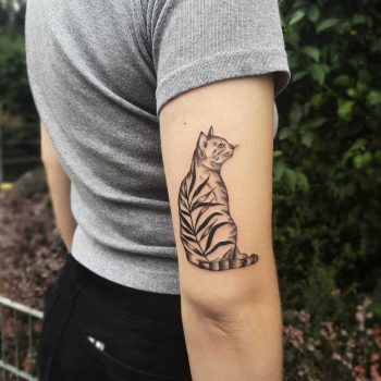 Cat and branch tattoo