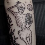 Chilling skeleton tattoo