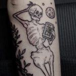 Chilling skeleton tattoo