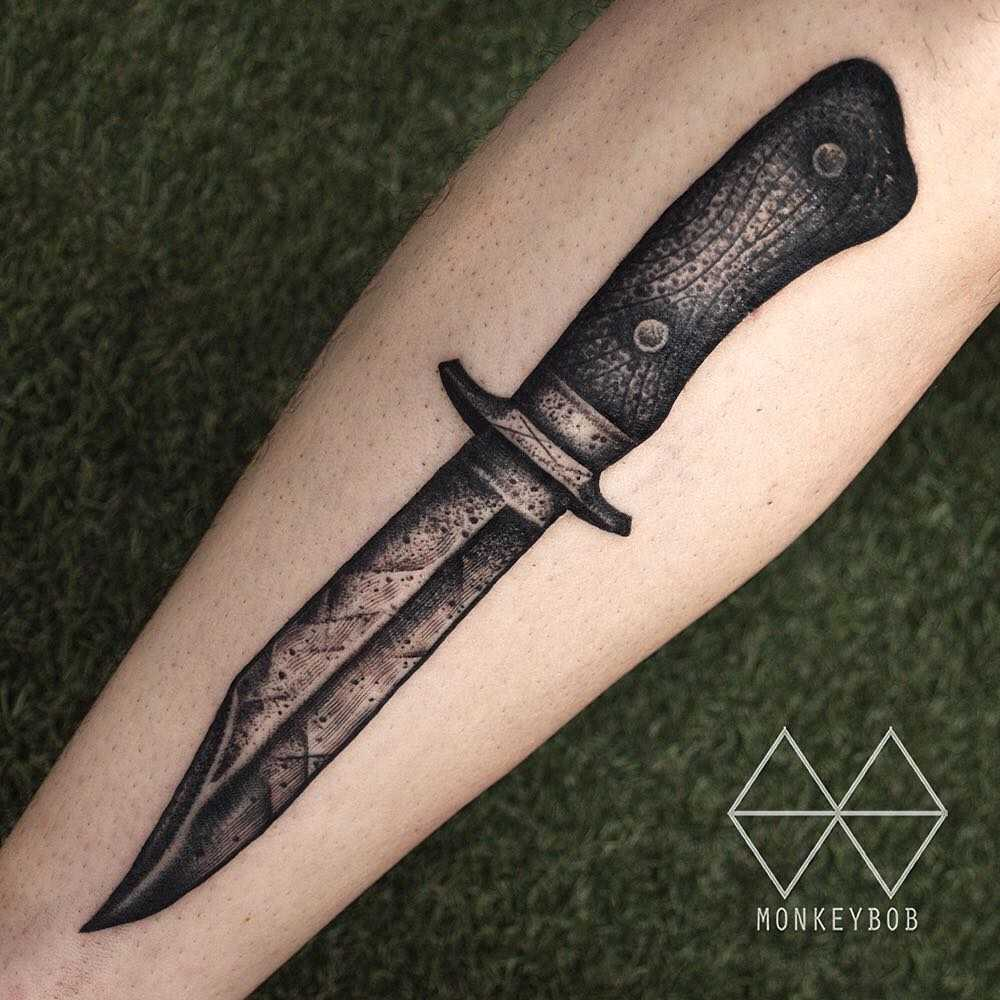 Classic knife tattoo by Monkey Bob