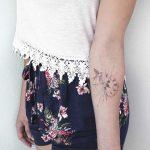 Clock and bird tattoo