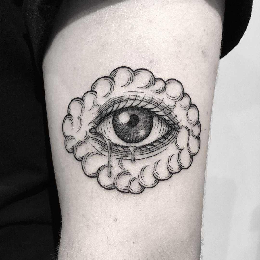 Cloudy eye tattoo