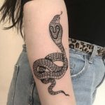 Cobra tattoo on the forearm