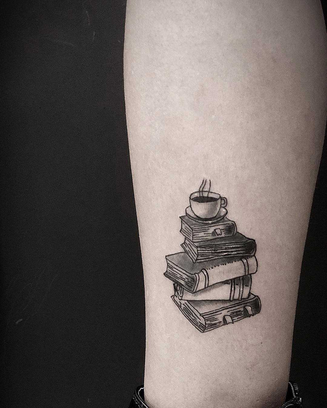 Coffee cup on a book pile