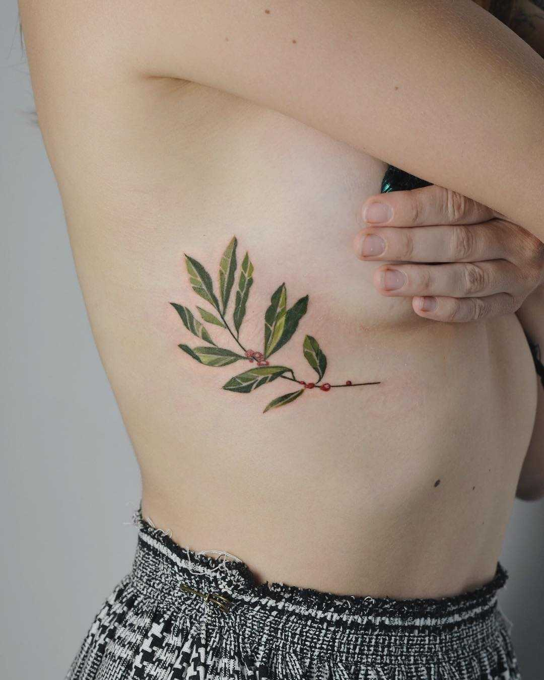 Coffee plant tattoo on the rib