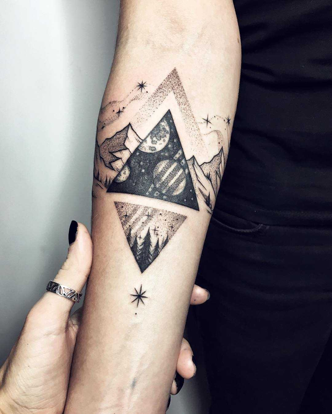 Cosmic triangle tattoo by Sasha Tattooing