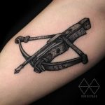 Crossbow tattoo on the arm
