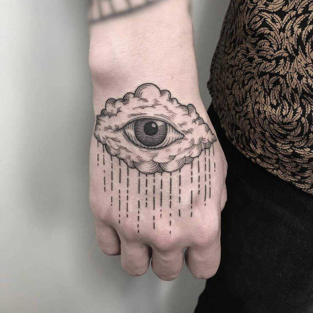 Crying cloud tattoo by Michele Volpi