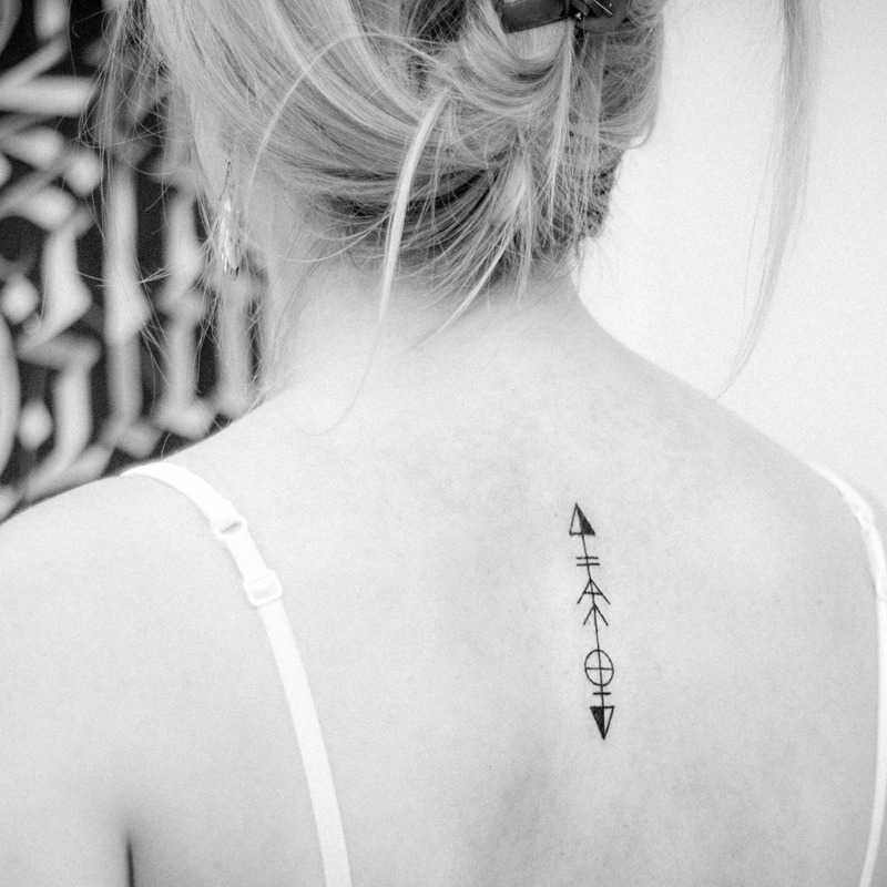 Custom arrow tattoo by Dogma Noir