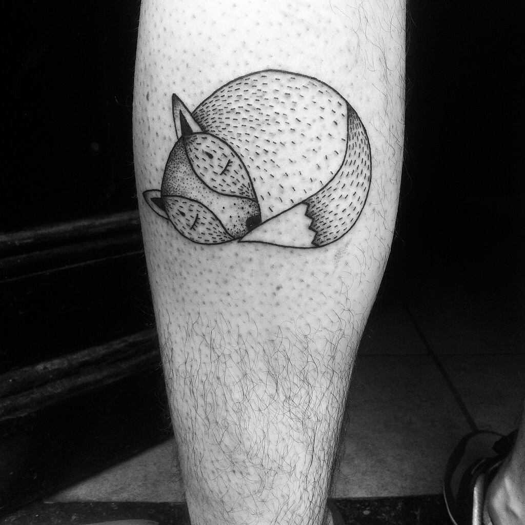Cute curled-up fox tattoo