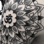 Detailed OM mandala tattoo by Daniel Jay Nodianos