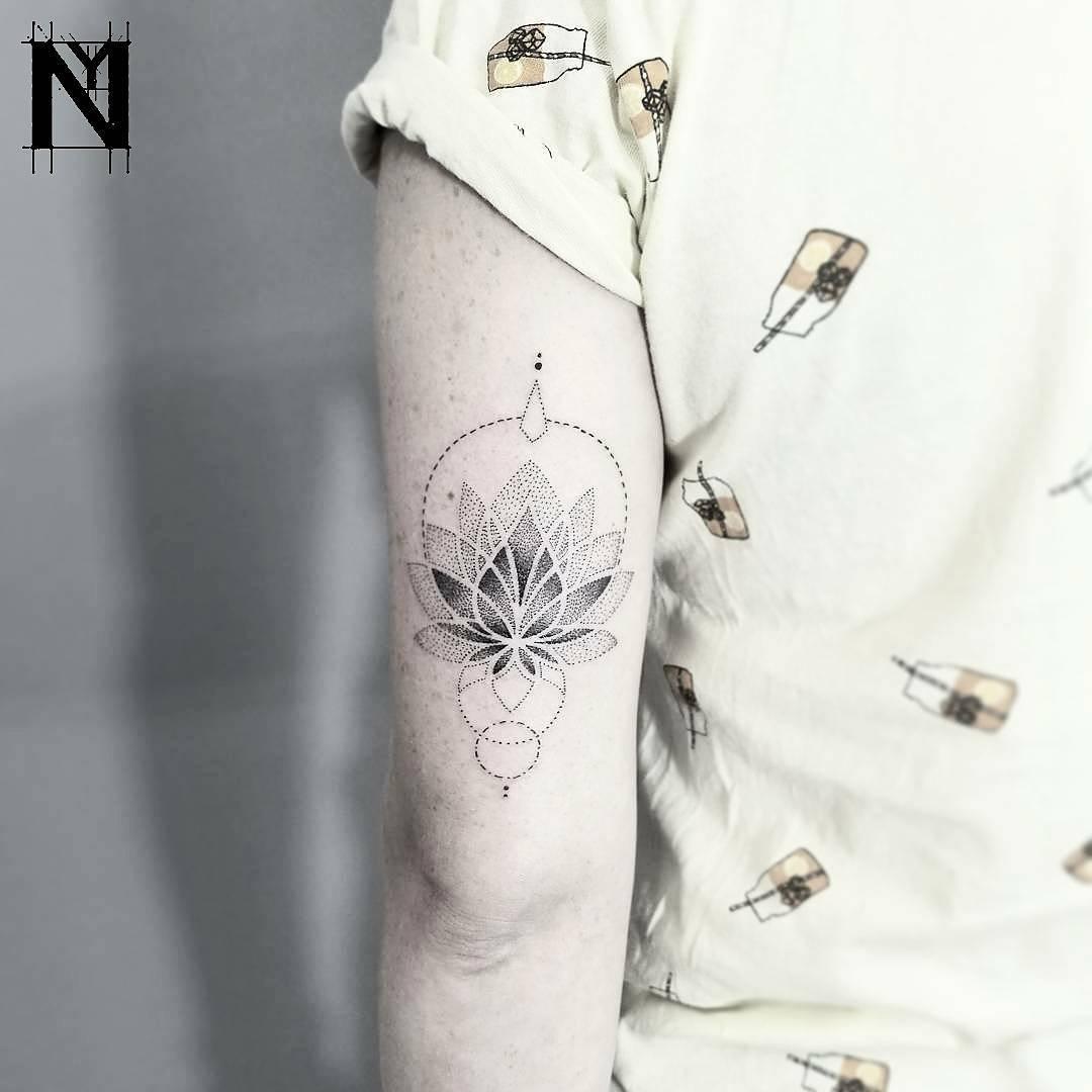 Dot-work Lotus and circles tattoo
