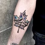 Double exposure maple leaf and landscape tattoo