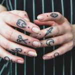 Finger tattoos by Rikamau