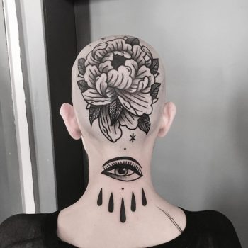 Flower and eye tattoo on the head