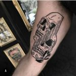 Glitchy skull tattoo