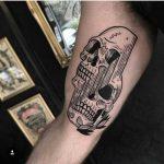 Glitchy skull tattoo