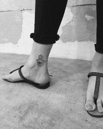Hamsa hand tattoo by Nerdy Match Marco