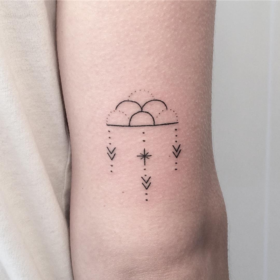 Hand-poked cloud tattoo