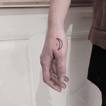 Hand-poked moon tattoo on the hand