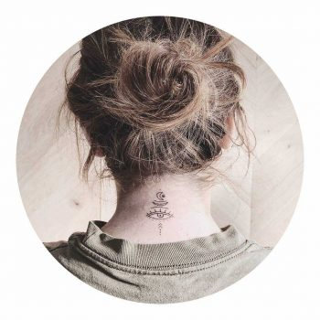 Hand-poked neck tattoo by Kate Kalula