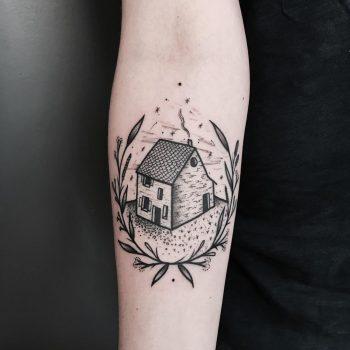 House and wreath tattoo