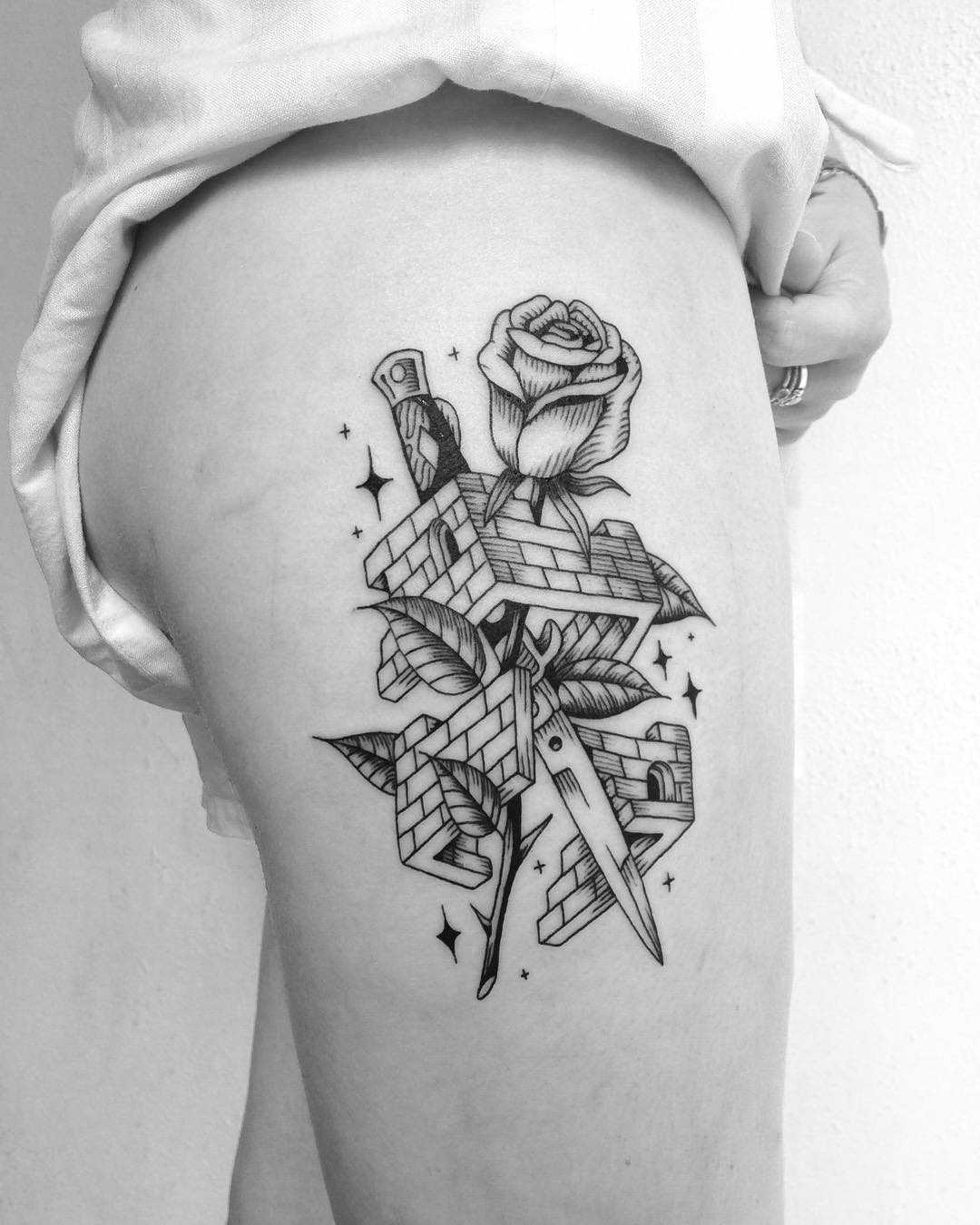 Knife, rose, and demolished house tattoo