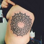 Large mandala tattoo on the left rib