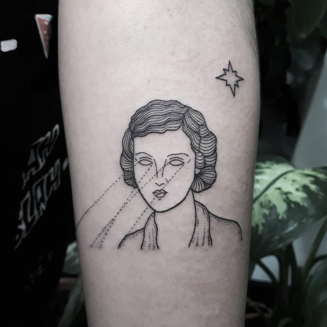 Laser beam lady tattoo