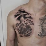 Lighthouse tattoo on the chest