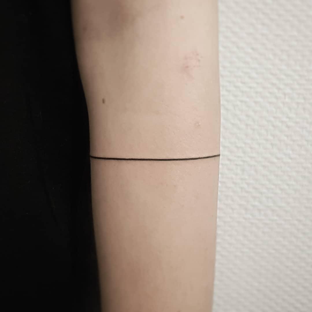 Line tattoo done at Mu Body Arts