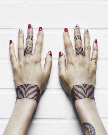 Linear chevron bracelet tattoos