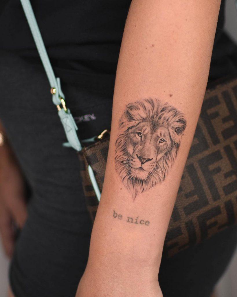 Lion head tattoo on the forearm