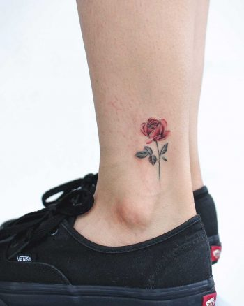Little red rose tattoo on the left ankle