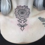 Mandala and lotus tattoo on the neck