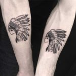 Matching Native American tattoos for brothers
