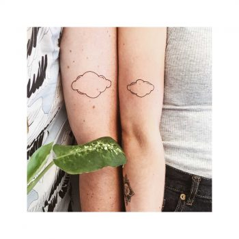 Matching cloud tattoos for a coupl