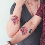 Matching flower tattoos for a couple