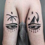 Matching magic eye tattoos