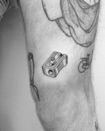 Minimalist pencil sharpener tattoo