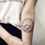 Mountainous landscape and Pisces symbol in the sky