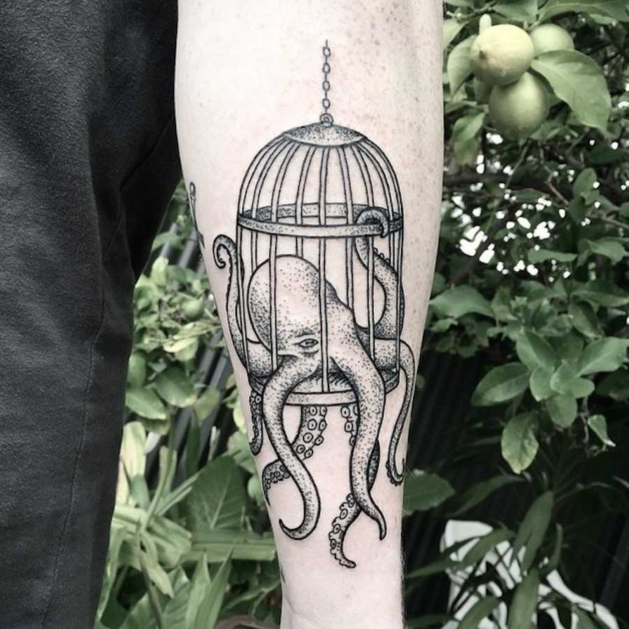Octopus in a cage tattoo