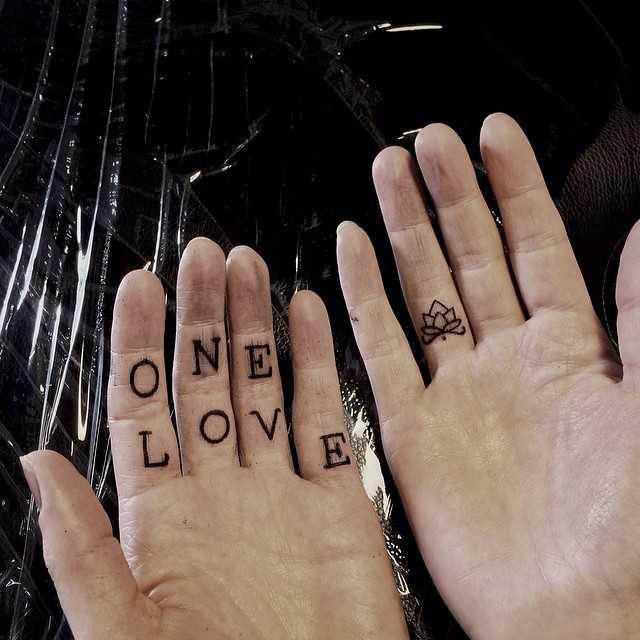 One love hand-poked tattoo