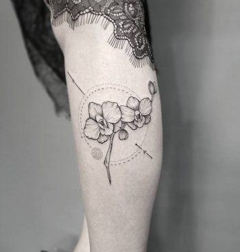Orchids tattoo on the calf