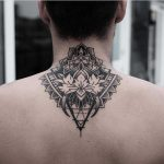 Ornamental tattoo on the back by Jonas Ribeiro