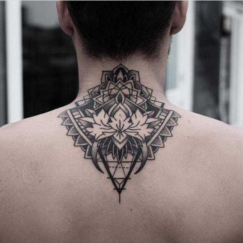 Ornamental tattoo on the back by Jonas Ribeiro