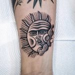Personified sun tattoo