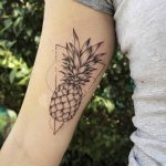 Pineapple and triangle tattoo on the arm